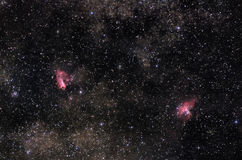 Nebulae of Milky Way. Astronomical photograph of rich star field with bright nebulae Omega and Eagle Stock Images