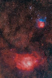 Nebulae in Sagittarius: Lagoon and Trifid Royalty Free Stock Photo