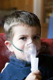 Nebuliser therapy. Child taking respiratory therapy asthma treatment Royalty Free Stock Images
