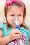 Nebulizer. Child makes himself at home inhalation Stock Photo
