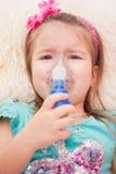 Nebulizer. Child makes himself at home inhalation Royalty Free Stock Photo