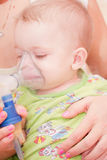 Nebulizer. Mom makes inhalation child nebulizer Stock Photo
