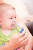 Nebulizer. Mom makes inhalation child nebulizer Royalty Free Stock Images