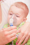 Nebulizer. Mom makes inhalation child nebulizer Royalty Free Stock Image