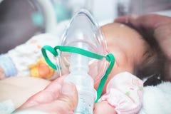 Nebulizer to a new born baby Stock Photo