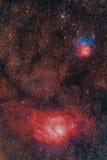 Nebulosas en sagitario: Laguna y trífido Foto de archivo libre de regalías