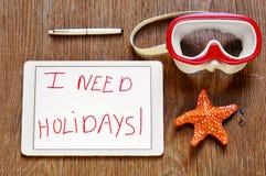 Necesito días de fiesta en una tableta y una máscara de la zambullida y una estrella de mar Imágenes de archivo libres de regalías