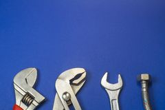 Necessary set of tools for plumbers on a blue background royalty free stock image