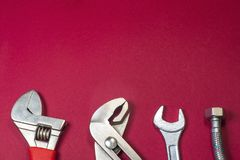 Necessary set of tools for plumbers on a red background stock photo