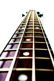 Neck of a bass guitar. With silver strings Royalty Free Stock Images