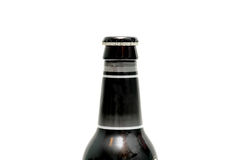 Neck of beer bottle with cap on Stock Photography