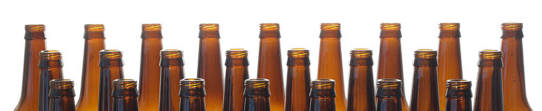 Neck beer bottles brown glass, isolated on white background. Royalty Free Stock Images