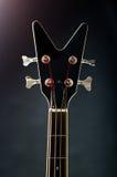 Neck of a black bass guitar Stock Photography