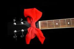 Neck of black guitar. Details of  acoustic black guitar. neck, nut, frets, strings Royalty Free Stock Image