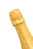 Neck of champagne bottle. Neck of closed champagne bottle packed in golden paper over white background Royalty Free Stock Photos