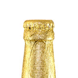Neck closed beer bottles wrapped in gold foil Royalty Free Stock Images