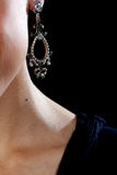 Neck and Earring on Black Stock Photo