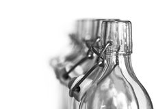 Neck of glass bottles with a porcelain stopper Stock Photography