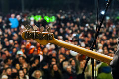 Neck guitar with blurred crowd on stage stock images