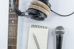 Neck guitar notebook in top view with music concept whitebackgr Royalty Free Stock Image