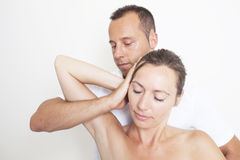 Neck manipulation. Chiropractic applying neck manipulation on female patient Royalty Free Stock Image