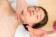 Neck massage professional cosmetician hands, top view. Close-up Stock Photo