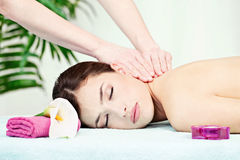 Neck massage in salon. Woman on neck massage in salon stock photo
