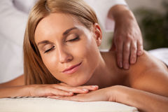 Neck massage in spa. Horizontal close-up of neck massage in spa royalty free stock photography