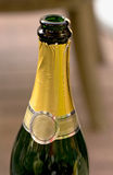 Neck of an open bottle of sparkling wine Stock Images