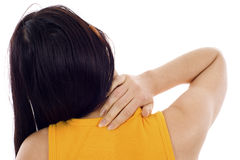 Neck Pain. Back View of a Woman with Neck Pain - Isolated over a white background Royalty Free Stock Photos