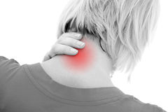 Neck pain. A woman suffering pain on her neck Royalty Free Stock Image