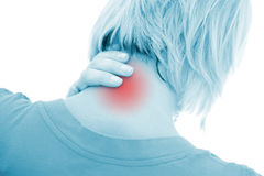 Neck pain. A woman suffering pain on her neck Royalty Free Stock Photos