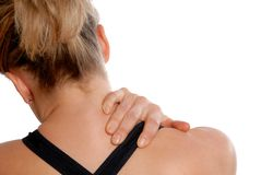 Neck pain. Woman in training gear holding her neck in pain Royalty Free Stock Photography