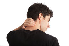 Neck pain. Man with his hand on his neck expressing that he has got a neck pain Stock Photos