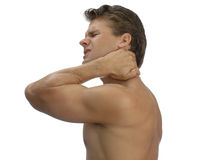 Neck pain. Topless male athlete in pain holding back of neck Royalty Free Stock Photos