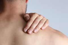 Neck pain. Acute pain in a neck at the young man Stock Images