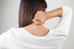 Neck,Pain in the back. Young woman having pain in the back and neck,Pain in the back royalty free stock photography