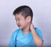Neck Pain. The boy Suffer From Neck Pain after waking up in the morning Stock Photography