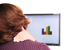 Neck pain - detail. Business person with neck pain behind computer monitor Stock Photography