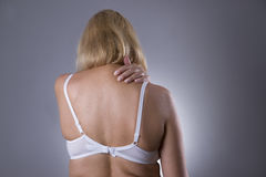 Neck pain, massage of female body, ache in woman`s body Stock Image