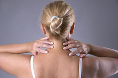 Neck pain, massage of female body, ache in woman`s body Royalty Free Stock Photos