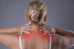 Neck pain, massage of female body, ache in woman`s body stock photography