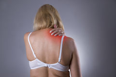 Neck pain, massage of female body, ache in woman`s body royalty free stock photo