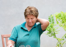 Neck pain. Older woman has neck pain stock photos