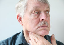 Neck pain in senior man Stock Photo