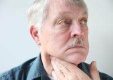 Neck pain in senior man Stock Photo