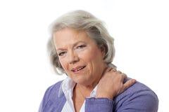 Neck pain. Senior woman has neck pain stock images