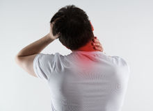 Neck pain. Young male massaging his neck in pain. Nape injury. Spine problem royalty free stock photos