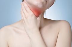 Neck pain. Young woman holding her painful neck stock images