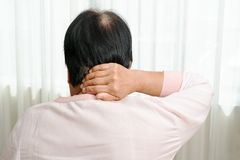Neck and shoulder pain, old woman suffering from neck and shoulder injury, health problem concept royalty free stock photography